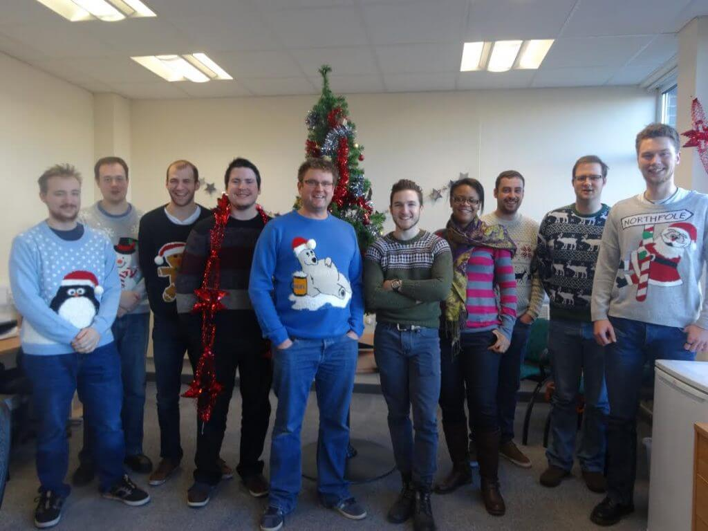 Optima Employees Wearing Christmas Jumpers