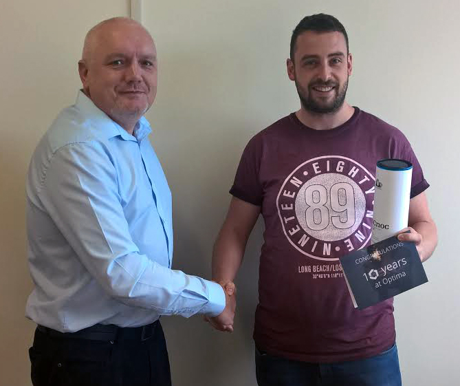 Neil shaking hands with Nathan celebrating 10 years at Optima Warehouse Solutions