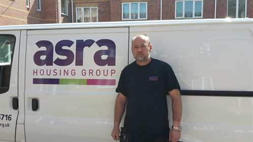 A person standing in front of the asra van