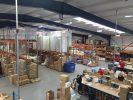Busy warehouse showing workers putting items in boxes for shipping