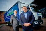 Lloyds PGS Directors standing by a Lloyds PGS lorry