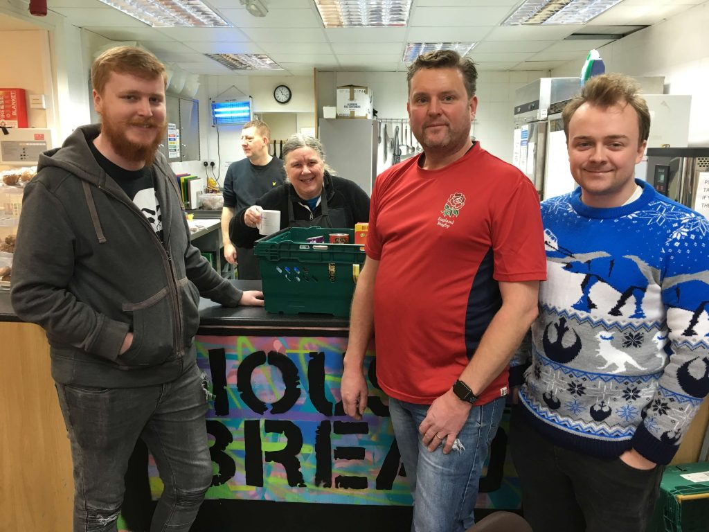 Optima Employees at House of Bread donating food at Christmas