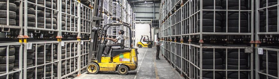 Fulfilment centre with forklift truck picking goods